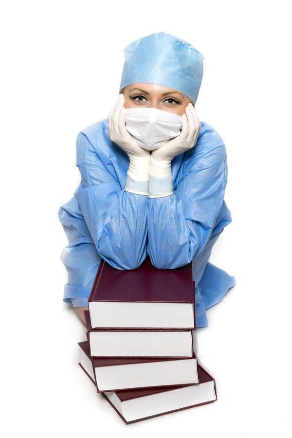 有书的外科医生 免版税库存照片