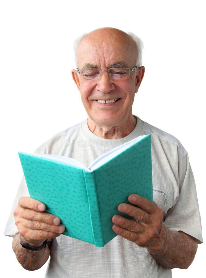 有书的老人 库存图片