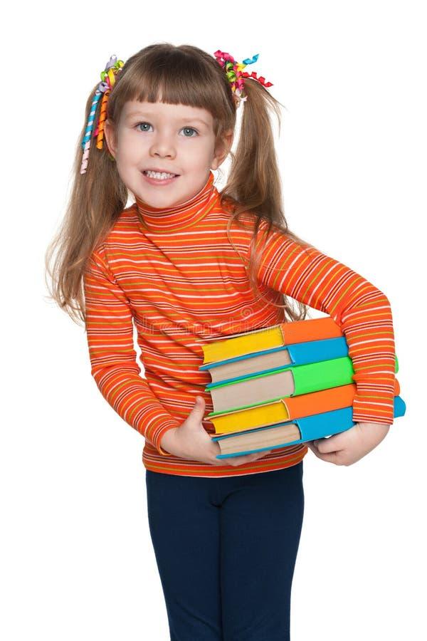 有书的聪明的小女孩 库存图片