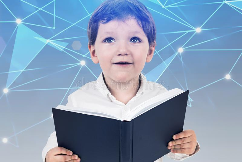有书的,数字教育概念小男孩 免版税图库摄影