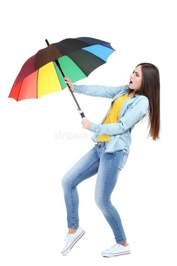 有五颜六色的伞的女孩 免版税库存图片