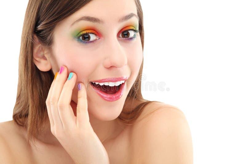 有五颜六色的眼影膏的惊奇的妇女 库存图片
