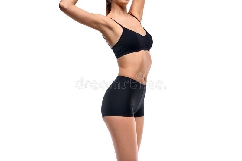 有亭亭玉立的身体的适合女性 库存图片