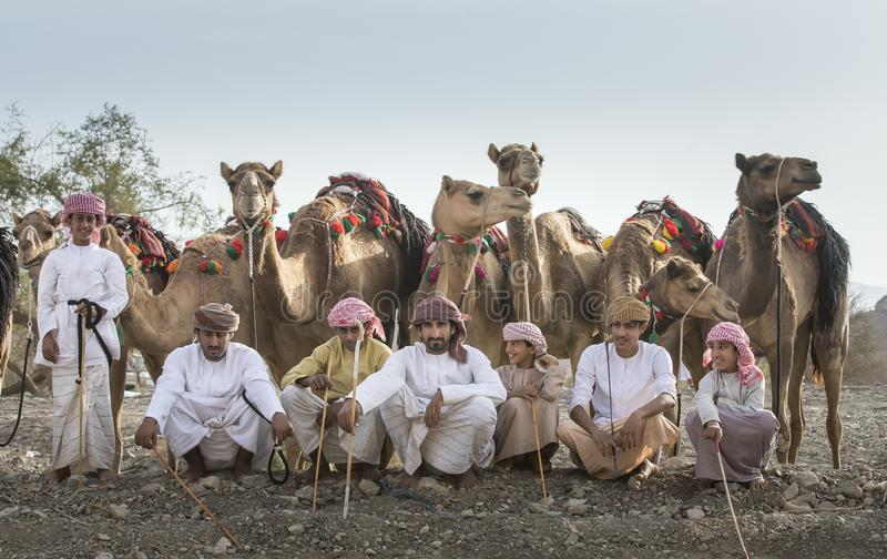有他们的骆驼的阿曼人 免版税库存图片