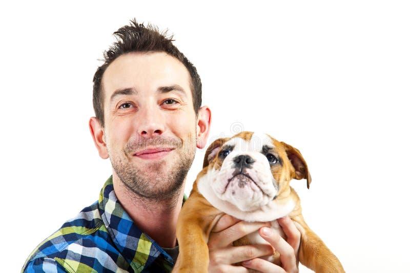 有他的狗的人在空白背景 免版税库存图片