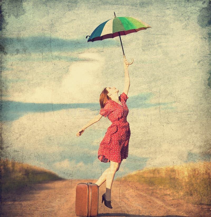 有伞的女孩 库存图片