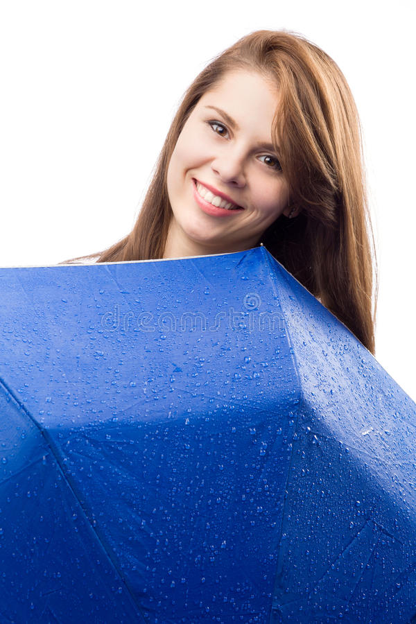 有伞的愉快的女孩 库存照片