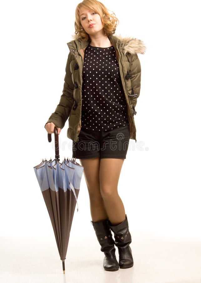 有伞的现代时髦的妇女 库存图片