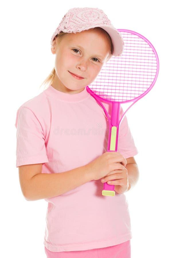 有作用网球的小女孩 库存照片
