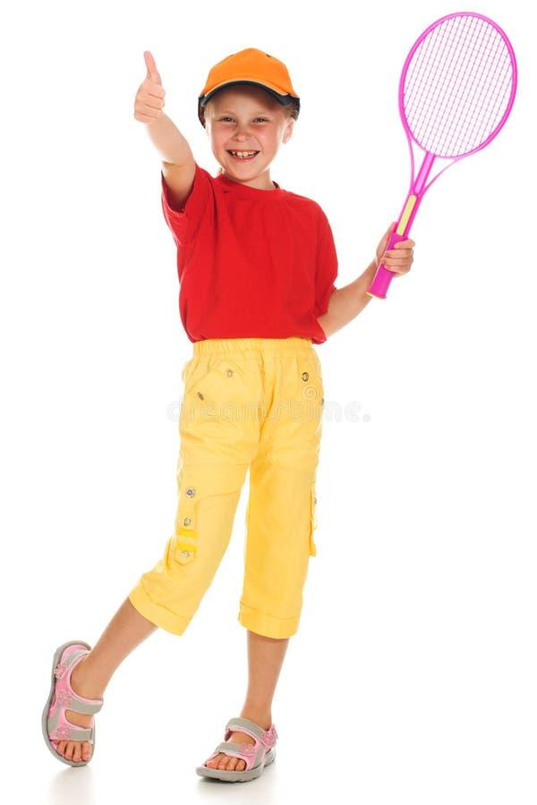 有作用网球的小女孩 免版税库存照片