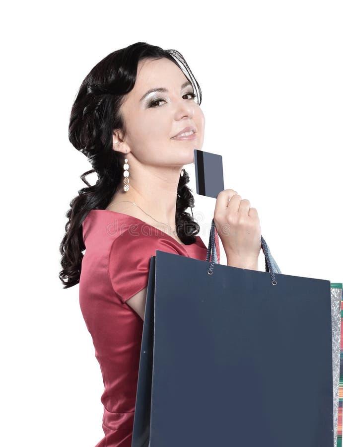 有信用卡的迷人的夫人 查出在白色 库存照片