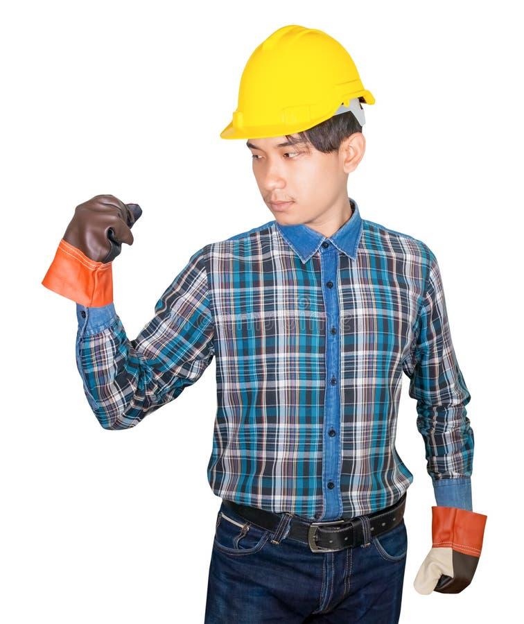 有做标志穿戴镶边衬衣蓝色和手套皮革与黄色安全帽塑料的拳头的工程学手在头 库存照片