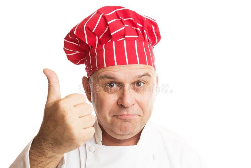 有做表示的红色帽子的厨师 库存照片