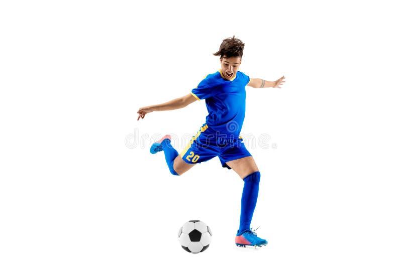有做飞行反撞力的足球的年轻男孩 免版税库存照片