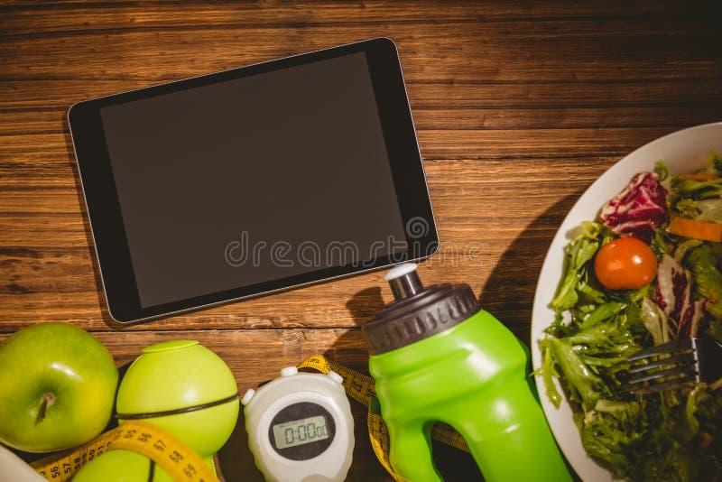有健康生活方式显示的片剂  库存照片