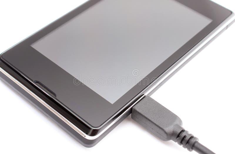 有充电器,智能手机充电的概念被连接的插座的手机  免版税库存图片