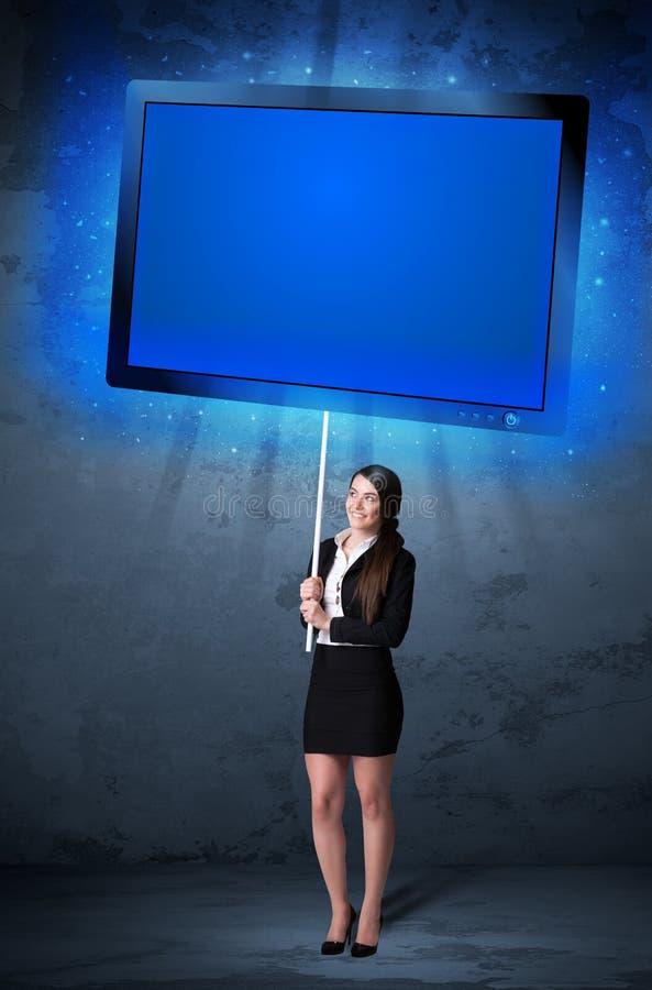 有光亮的片剂的女实业家 库存图片