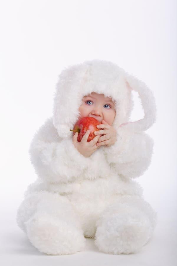 有兔子服装的逗人喜爱的婴孩 免版税库存照片