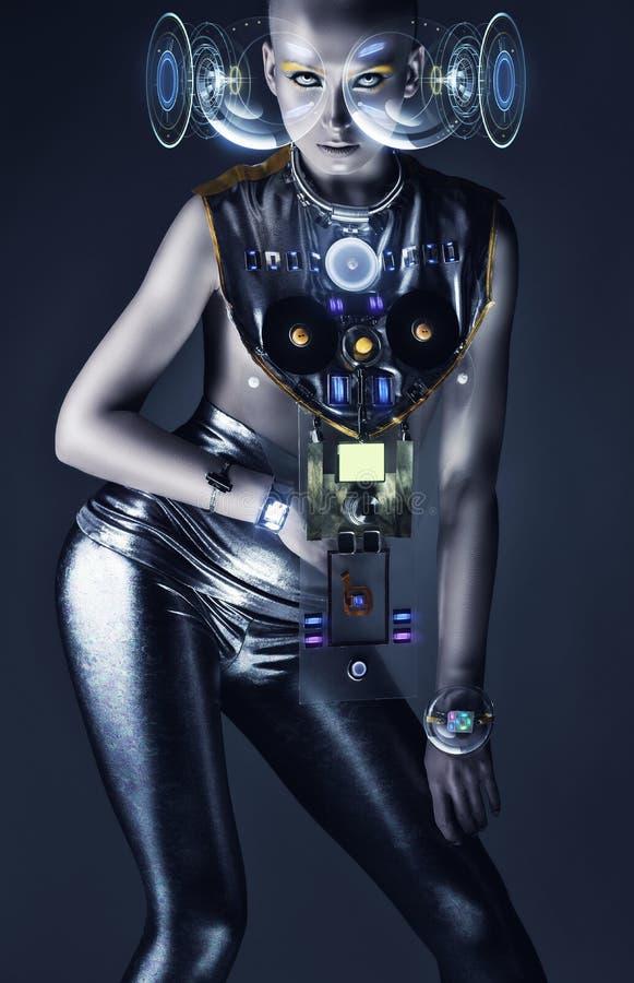 有全息图显示和techno衣服的靠机械装置维持生命的人妇女 库存照片