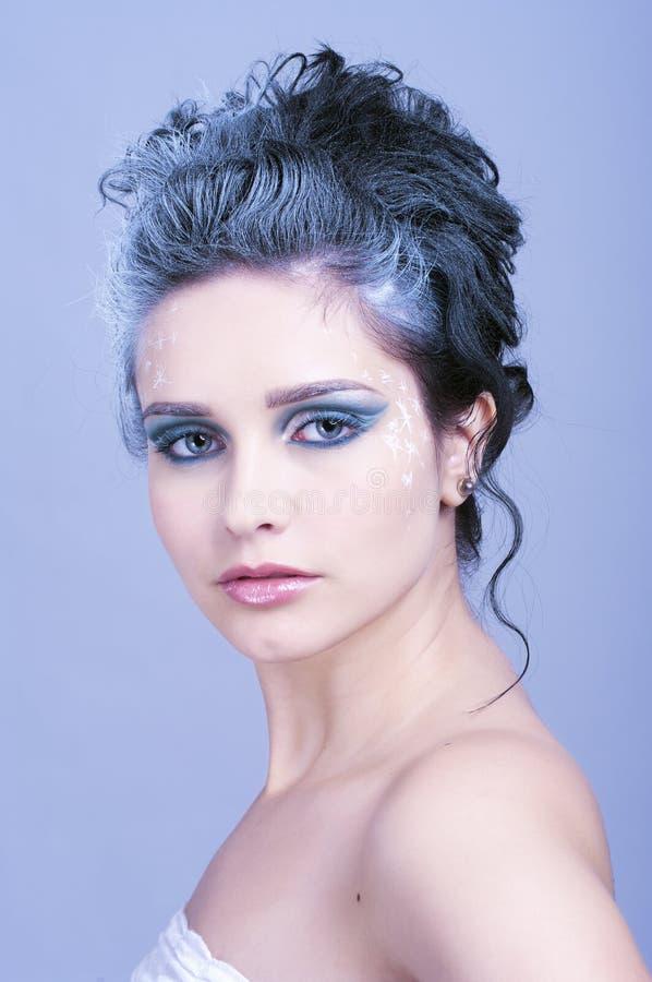 有冬天样式构成的美丽的妇女 图库摄影