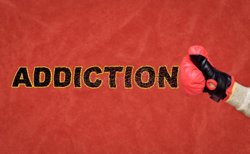 有击中和打破词瘾的一个拳击手套的人的拳头 库存照片