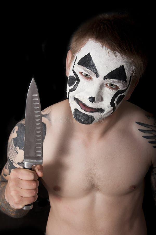 有刀子的邪恶的小丑 图库摄影