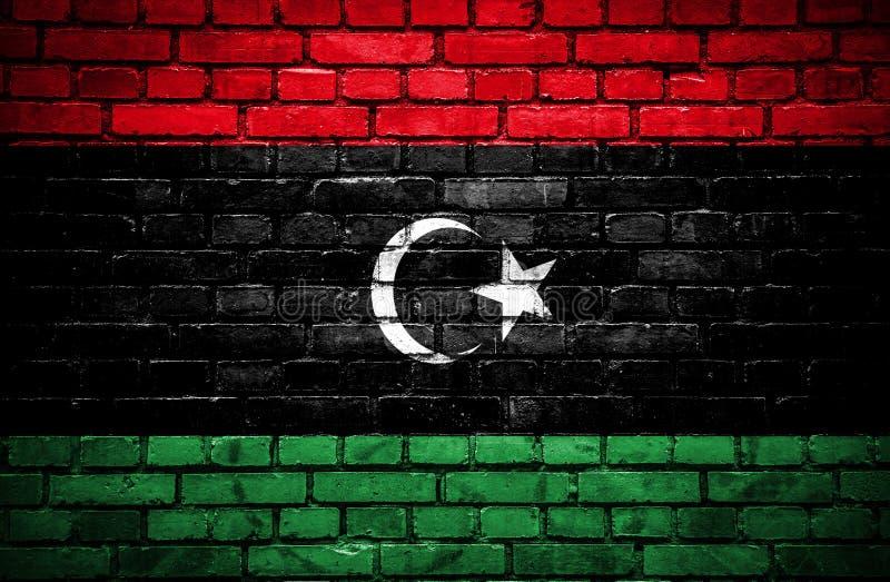 有利比亚的被绘的旗子的砖墙 库存例证