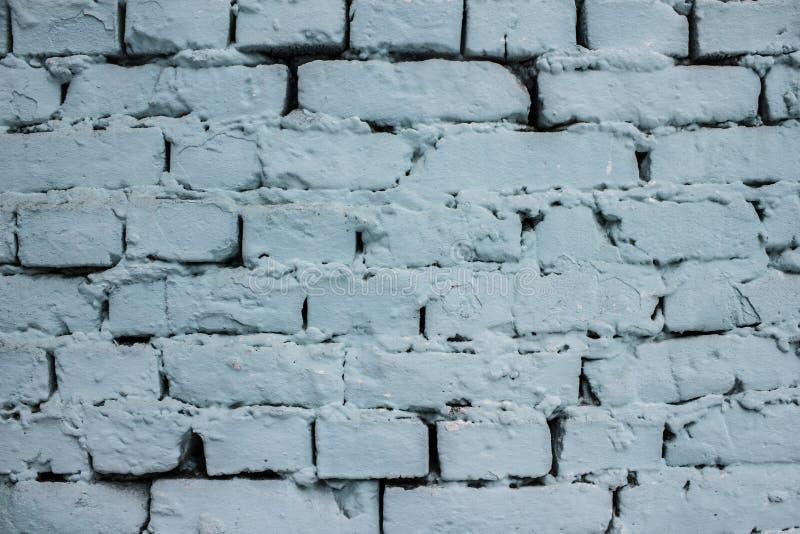 有削皮油漆背景纹理的蓝色砖墙 库存照片