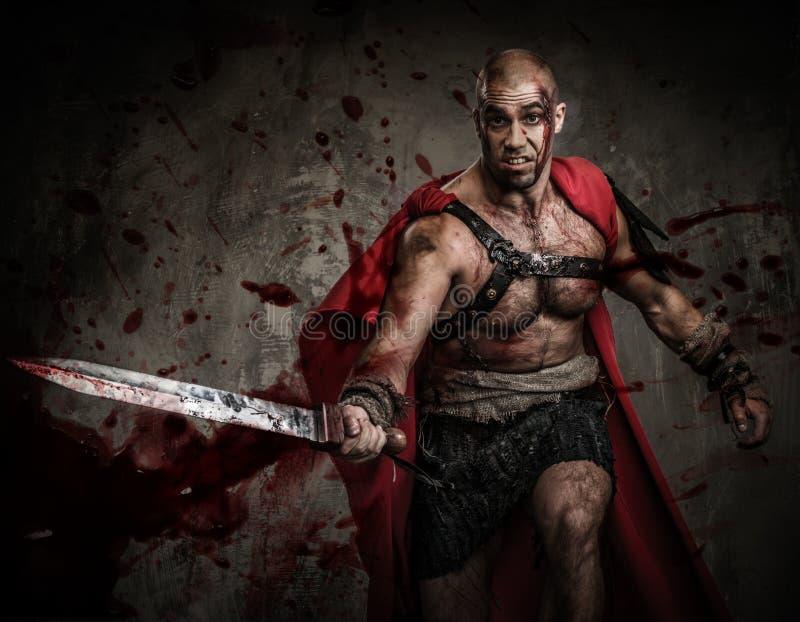 有剑的受伤的争论者 库存照片