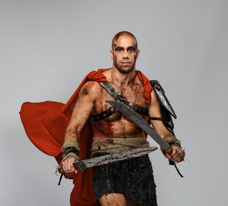 有剑的受伤的争论者 库存图片