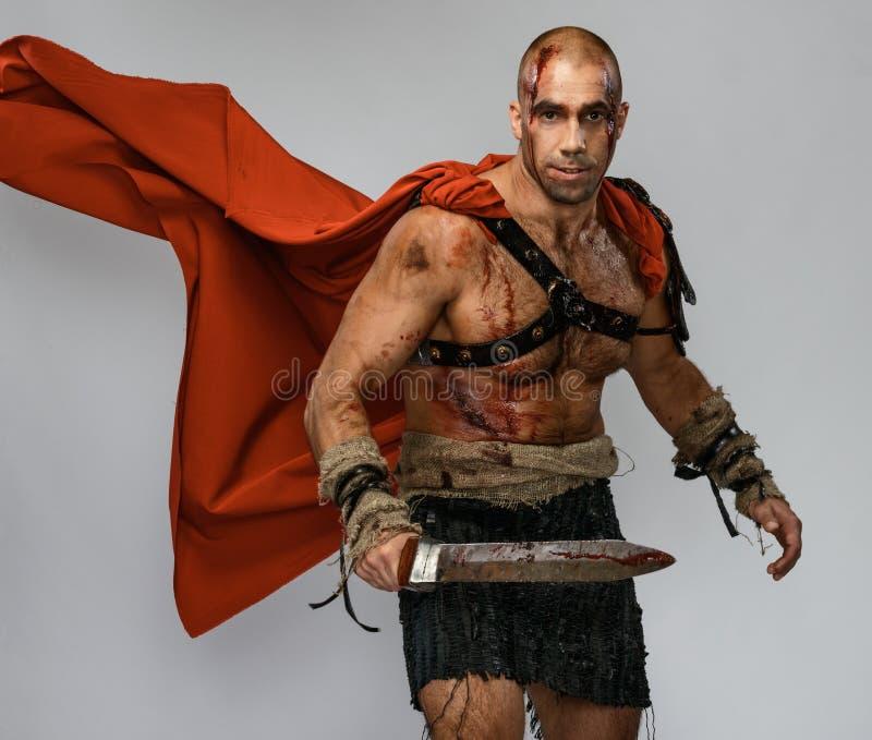 有剑的受伤的争论者 免版税库存照片