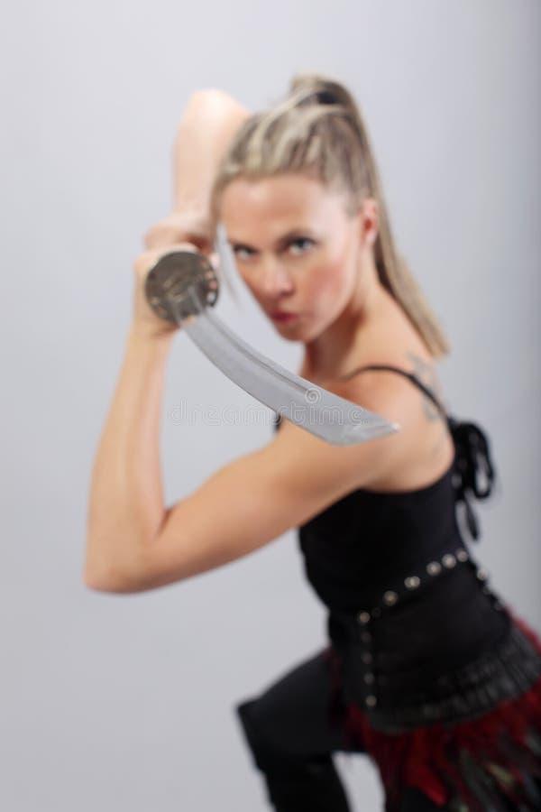 有剑的妇女 免版税库存照片