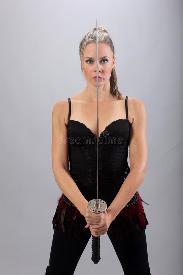有剑的妇女 图库摄影