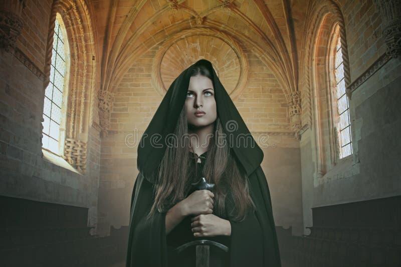 有剑的骑士妇女 库存图片