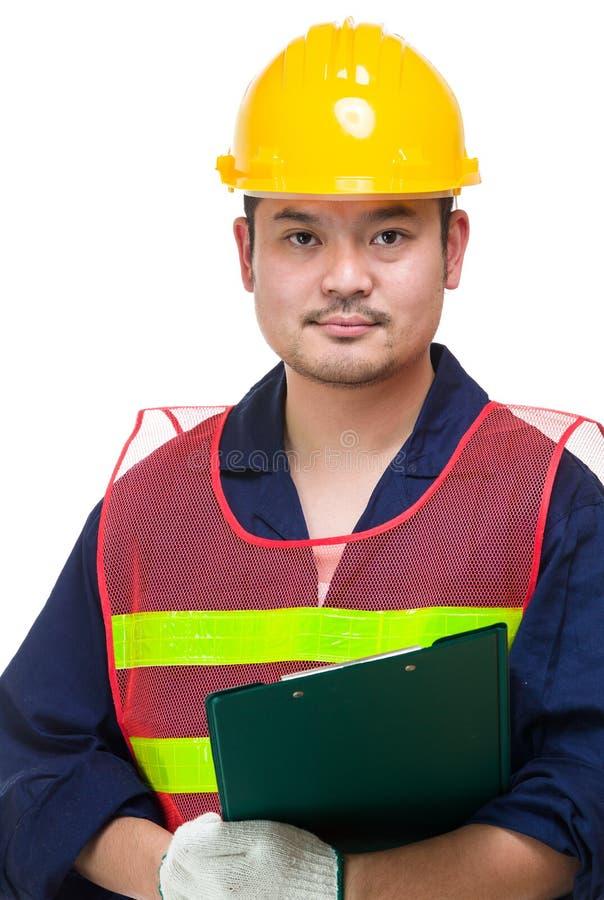有剪贴板的严肃的亚裔工头 免版税库存照片