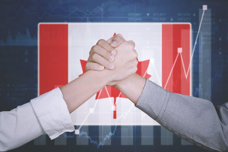有加拿大旗子的商务伙伴 图库摄影