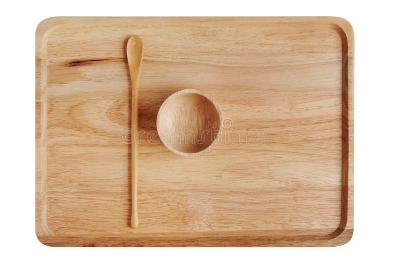 有匙子和小碗的空的木板材 免版税库存照片