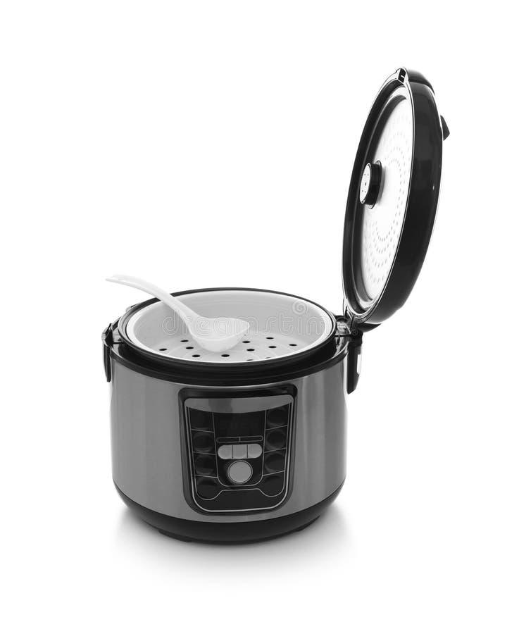 有匙子的现代电多烹饪器材 免版税库存图片