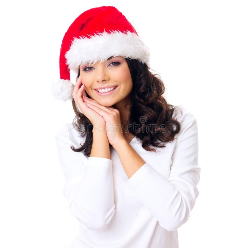 有华美的微笑的少妇在圣诞老人帽子 图库摄影