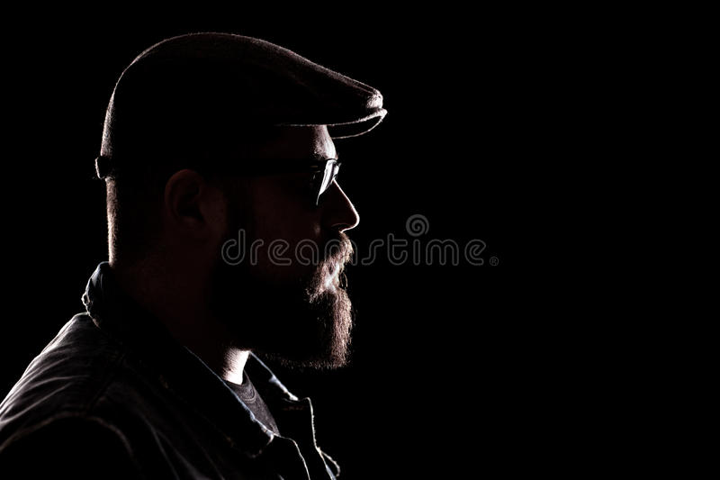 有厚实的胡子和贝雷帽的行家 免版税库存图片