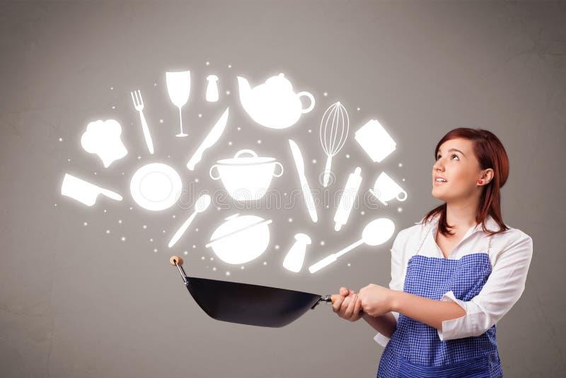 有厨房辅助部件图标的少妇 库存图片