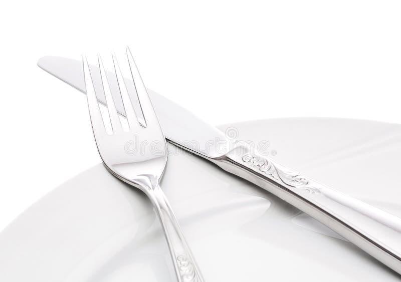 有叉子和刀子的板材 免版税库存照片
