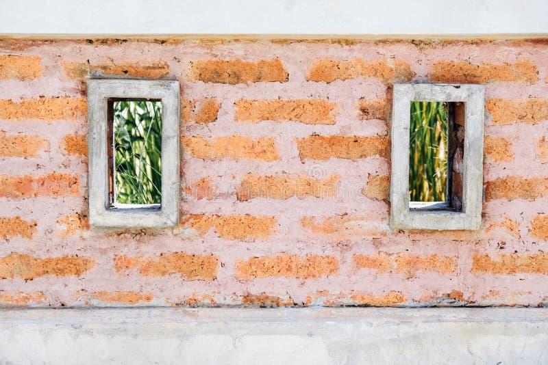 有双重正方形的老红砖墙壁,墙纸纹理背景 免版税库存图片