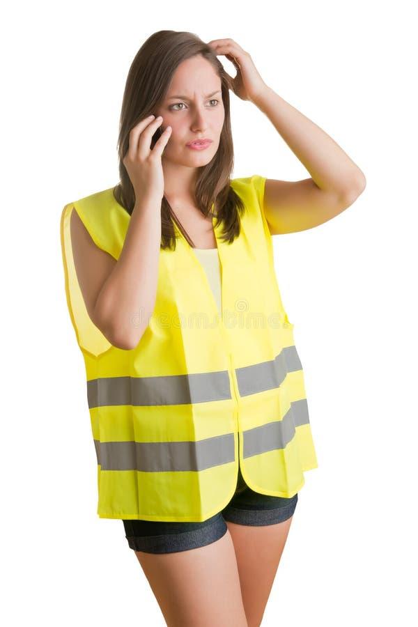 有反射器背心的妇女 免版税库存照片