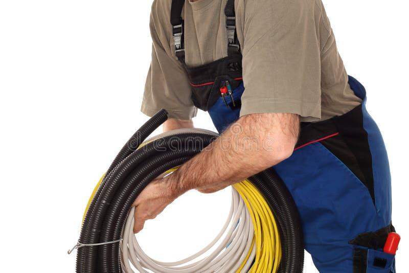 有另外缆绳的工人 图库摄影