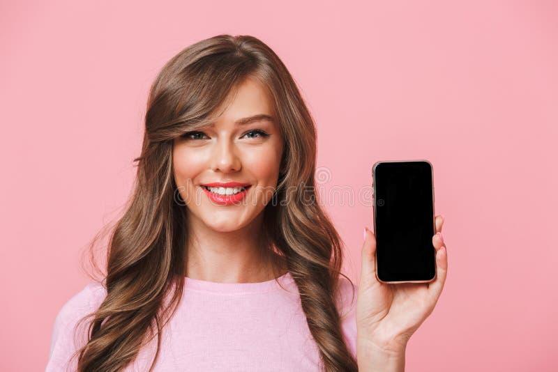 有可爱的妇女的图象拿着cel的美丽的长的头发 库存照片