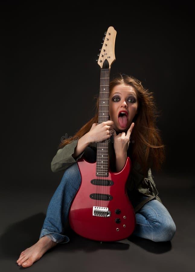 有吉他的妇女 免版税库存照片