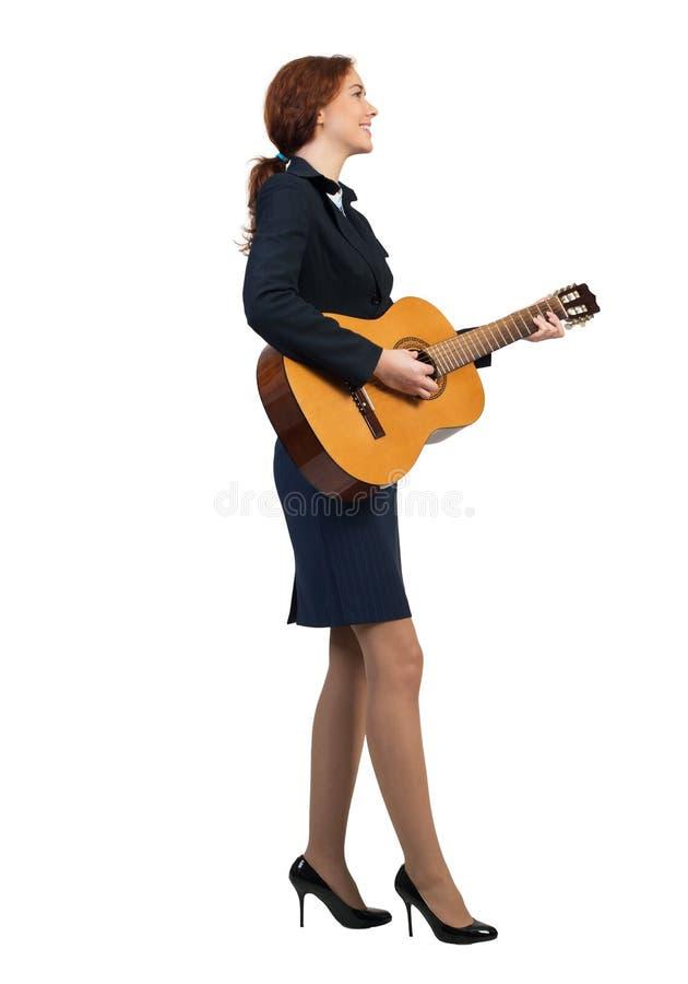 有吉他的女实业家 免版税图库摄影