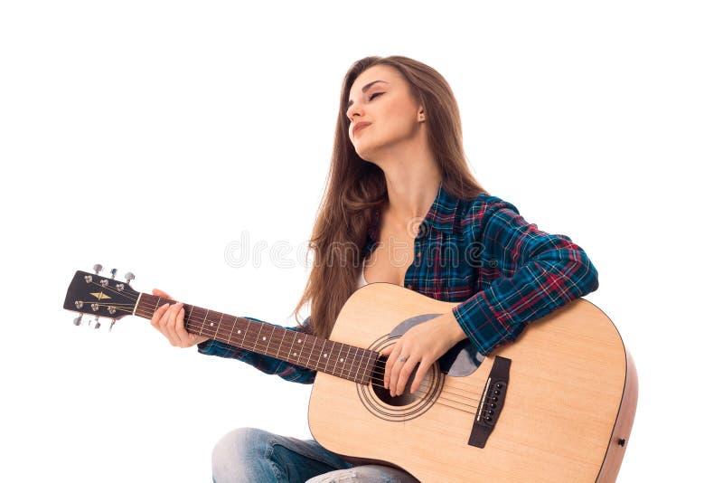 有吉他的魅力夫人在手上 库存图片