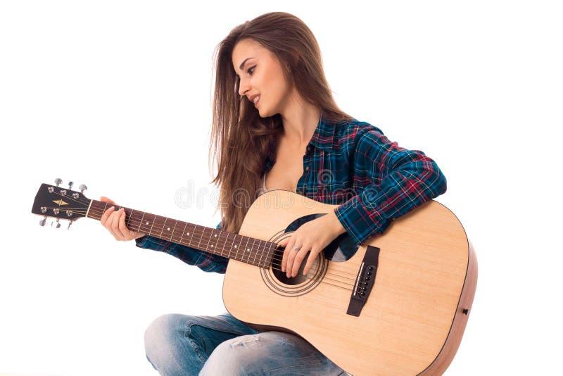 有吉他的魅力夫人在手上 库存照片